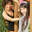 Mother and daughter in the park are held for the wooden beam — Stock Photo