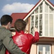 Young couple and house - Stock Photo