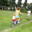 Royalty-Free Stock Photo: Family on bicycles