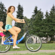 Mother and daughter ride on bicycle 2 — Stock Photo #7434467