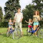 Family of four with bikes — Stock Photo #7434474
