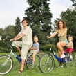 Family on bicycles — Stock Photo #7434477