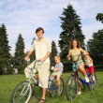 Family with bikes — Stock Photo #7434481