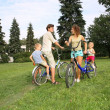 Royalty-Free Stock Photo: Parents with on bikes