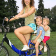 Mother with children on bike — Stock Photo #7434491