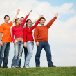 On the grass with the raised hands — Stock Photo