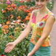 Stock Photo: Young woman and flowers