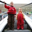 Children on the escalator — Stock Photo