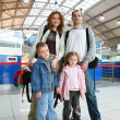 Standing traveling family of four — Stock Photo