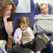 Family in plane — Stock Photo