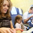 Family in plane 2 — Stock Photo