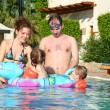 Man women childrens pool — Stock Photo #7434965