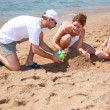 Family on beach — Stockfoto #7434999