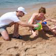Foto Stock: Familly on beach 2