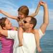 Stock Photo: Mother, daughter and father on the sea