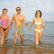 Man and two girls leave the sea — Stock Photo