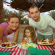 Family behind a little table of restaurant — Stock Photo