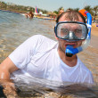 Man with snorkel in mouth - Stock Photo