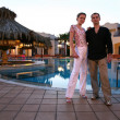 Couple in the evening hotel — Stock Photo