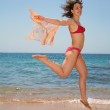 The woman in a jump at the sea — Stock Photo