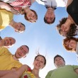 Group of nine friends are in a circle — Stock Photo