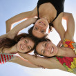 Stock Photo: Three woman on sky