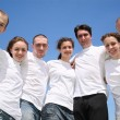 Royalty-Free Stock Photo: Group of friends in white T-shorts are in a circle