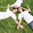 Stock Photo: Women grass laying