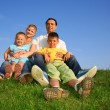 Sitting family grass sky — Stock Photo