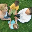 Sitting family grass — Stock Photo