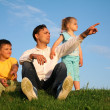Stock Photo: Family grass sky
