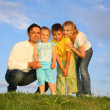 Family grass sky — Stock Photo