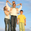 Standing family grass sky — Stock Photo