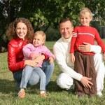Family in park — Stock Photo