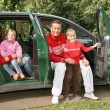 Family sitting in car - Stock Photo