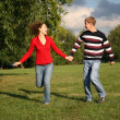 Attractive couple walking outdoors together - Foto Stock