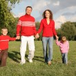 Stock Photo: Father and mother walk with children