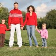 Parents stand holding children for the hands — Stockfoto