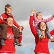 Stock Photo: Children on parents shoulders