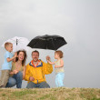 Family with the umbrellas — Stock Photo