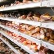 Shelfs with smoked meat - Stok fotoğraf