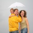 Family with the umbrella — Stock Photo
