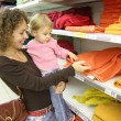 Mother with baby in shop — Stock Photo