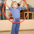 Baby play with hoop - Stock Photo