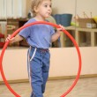 Little girl and hoop - Stock Photo