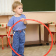 Little girl play with hoop — Stock Photo