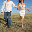 Running couple on meadow — Stock Photo