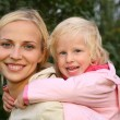 Girl embraces the mother - Stock Photo