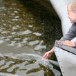 Child near the fountain - Stock Photo