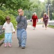 Children on the path in the park - Stock Photo